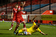 Walsall midfielder Stuart Sinclair (#7) is fouled during the EFL Sky Bet League 2 match between Crawley Town and Walsall at The People's Pension Stadium, Crawley, England on 16 March 2021.