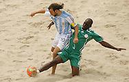 Football-FIFA Beach Soccer World Cup 2006 - Group D-Argentina - Nigeria, Beachsoccer World Cup 2006. Argentina's Ezequiel Lopez and Nigeria`s Okparal- Rio de Janeiro - Brazil 02/11/2006<br /> Mandatory credit: FIFA/ Manuel Queimadelos