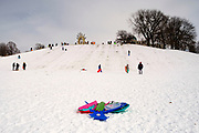 02 JANUARY 2021 - DES MOINES, IOWA: A pile of wrecked sleds on the hill below the Iowa Supreme Court. The hill is one of the most popular spots in Des Moines for sledding and winter play. Hundreds of people took advantage the warmer weather and the week's record snow to spend time on the slopes around the Supreme Court and neighboring capitol. The high temperature Saturday was about 25F (-4C).      PHOTO BY JACK KURTZ
