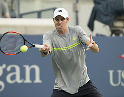 August 22, 2017 - New York, New York, United States - Reilly Opelka of USA returns ball during qualifying game against Alexander Sarkissian of USA at US Open 2017 (Credit Image: © Lev Radin/Pacific Press via ZUMA Wire)
