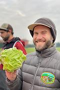 Brian Shipman of Wild Roots Farm holding white chioggia