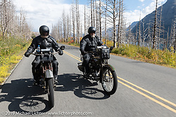 Father and Son - Bill and Billy Page riding their Harley-Davidsons through Glacier National Park on the Motorcycle Cannonball coast to coast vintage run. Stage 12 (242 miles) from Great Falls to Kalispell, MT. Thursday September 20, 2018. Photography ©2018 Michael Lichter.