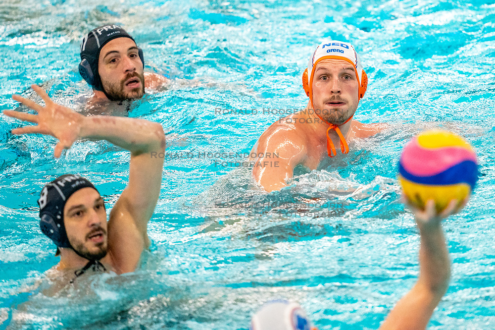 Jesse Nispeling of the Netherlands in action against David Babic of France during the Olympic qualifying tournament. The Dutch water polo players are on the hunt for a starting ticket for the Olympic Games on February 17, 2021 in Rotterdam