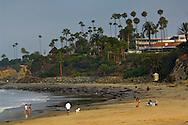 People on the sand and waves on beach at Laguna Beach, Orange County, California