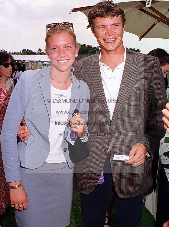 MISS CHLOE SIEVEWRIGHT and polo player MR JACK KIDD, brother of model Jodie Kidd, at a polo match in Berkshire on 25th July 1999.MUM 213