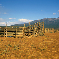USA, New Mexico, Taos County.  Scenic mountains and Wheeler Peak provide the backdrop for Taos Pueblo land, and this farmstead.