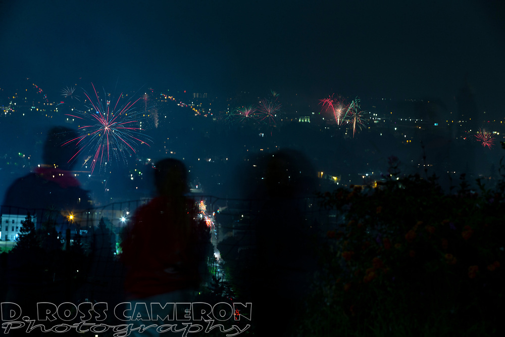 Spectators watch unauthorized fireworks explode over Oakland, Calif., as the United States celebrates the 243rd anniversary of its independence from Great Britain, Thursday, July 4, 2019. (Photo by D. Ross Cameron)