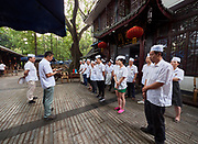China, Sichuan. Chengdu. Morning in People's Park 人民公园. Heming Tea House staff getting instructions for the day.