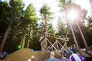 A competitor leaps off the Surgeon's Table during the Slopestyle event at the inaugural Crankworx Rotorua event held at Skyline Rotorua, Rotorua, New Zealand, March 25-29, 2015.