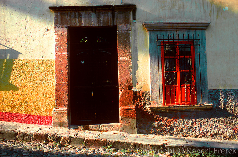 MEXICO, COLONIAL CITIES San Miguel de Allende; colonial city with many gringo residents; painted wall with doorway and window