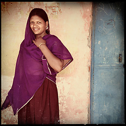 """iPhone portrait of Babli Maayida, approximate age 14, in a village outside of Banswara, Rajasthan, India, April 6, 2013. """"I did not like it when they said they want to get me married. I said, 'I'm very young right now and I don't want to get married. I want to study. . . . I'm a child,"""" said Maayida.<br /> <br /> Under Indian law, children younger than 18 cannot marry. Yet in a number of India's states, at least half of all girls are married before they turn 18, according to statistics gathered in 2012 by the United Nations Population Fund (UNFPA). However, young girls in the Indian state of Rajasthan—and even a few boys—are getting some help in combatting child marriage. In villages throughout Tonk, Jaipur and Banswara districts, the Center for Unfolding Learning Potential, or CULP, uses its Pehchan Project to reach out to girls, generally between the ages of 9 and 14, who either left school early or never went at all. The education and confidence-building CULP offers have empowered young people to refuse forced marriages in favor of continuing their studies, and the nongovernmental organization has provided them with resources and advocates in their fight."""