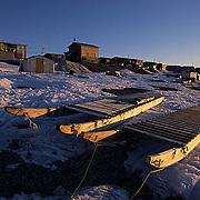 Canada, Nunavut Territory, Dog sleds in the town of Igloolik.