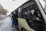 Passengers walk out of a minibus nearby Kond neighbourhood in Yerevan, Armenian capital on Friday, Jan 15, 2021. The most common type of public transportation is the minibuses, especially when it comes to routes outside Yerevan. There are buses and even trolleybuses too. All the signs and names of the bus stops and areas on city buses and marshrutkas are in Armenian. If there are no free seats on the bus, doesn't mean you cannot get on the bus at all. (Photo/ Vudi Xhymshiti)
