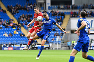 Jonathan Howson (16) of Middlesbrough battles for possession with Will Vaulks (6) of Cardiff City during the EFL Sky Bet Championship match between Cardiff City and Middlesbrough at the Cardiff City Stadium, Cardiff, Wales on 23 October 2021.