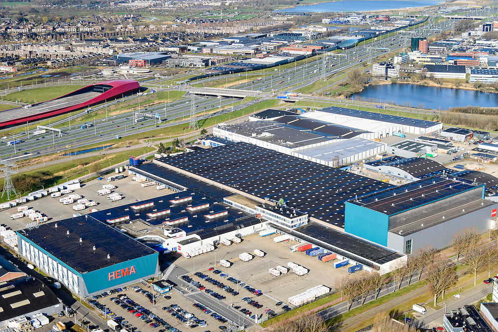 Nederland, Utrecht, Gemeente Utrecht, 01-04-2016; Bedrijventerrien Lageweide, Hema distributiecentrum. In de achtergrond A2 (met The Wall) en Leidsche Rijn.<br /> <br /> <br /> distribution centre for Hema<br /> <br /> luchtfoto (toeslag op standard tarieven);<br /> aerial photo (additional fee required);<br /> copyright foto/photo Siebe Swart
