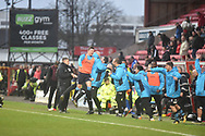 The Woking bench celebrate victory  during the The FA Cup 2nd round match between Swindon Town and Woking at the County Ground, Swindon, England on 2 December 2018.