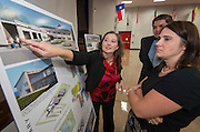 Houston ISD staff, English & Associates architects and community members participate in a community meeting to discuss the progress on Mark White Elementary School at Revere Middle School, July 22, 2014.