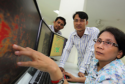Staff monitor local and national weather conditions from the control centre in the tower of the Meteorology centre radar centre in Phnom Penh. Cambodia.