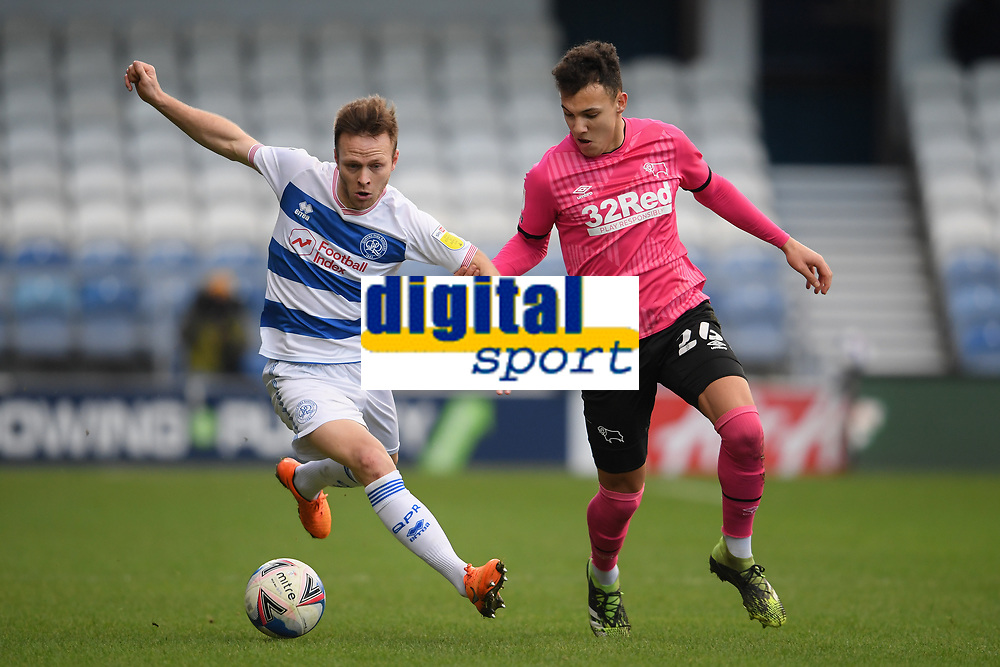 Football - 2020 / 20-21 Sky Bet Championship - Queens Park Rangers vs Derby County - Kiyan Prince Foundation Stadium<br /> <br /> Todd Kane of Queens Park Rangers holds off the challenge from Lee Buchanan of Derby County.<br /> <br /> COLORSPORT