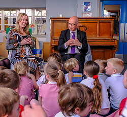 Pictured: Teacher Lisa Black and John Swinney lead the students in reading and singing<br /><br />John Swinney headed to Hermitage Park Primary School today to read his favourite bedtime story to pupils to promote the school's 'coorie in' project, an online channel that shares bedtime stories and promotes literacy.<br /><br /> Ger Harley | EEm 14 May 2019