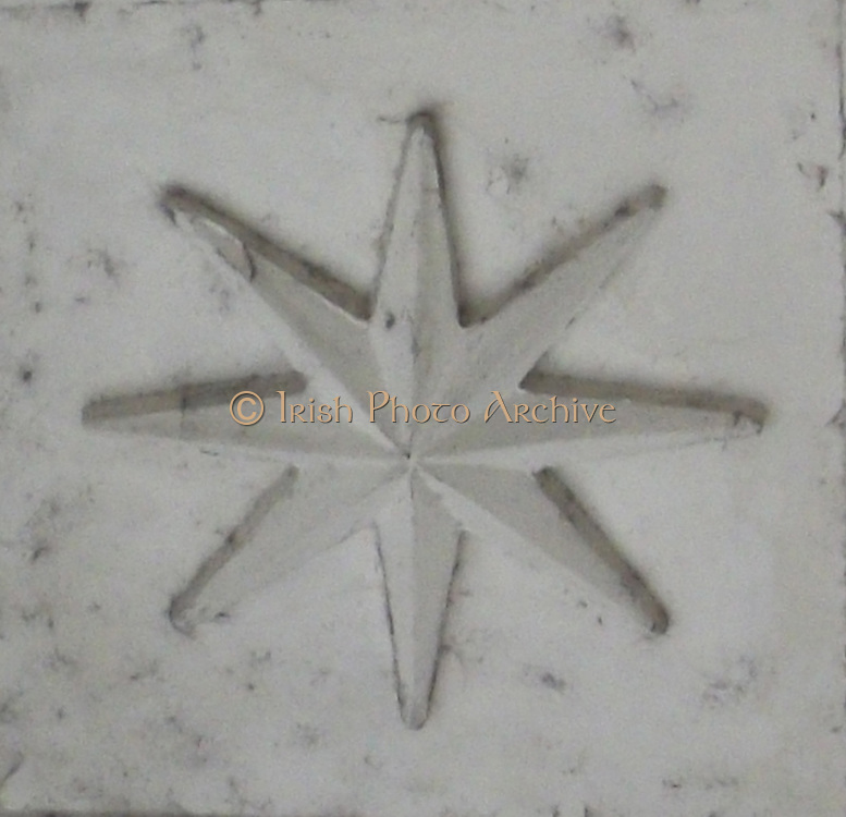 Architectural relief detail in Saint Peter's Square in the Vatican City, Italy. Showing a star shape in the stonework.