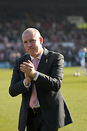 Brentford Manager Mark Warburton acknowledging the home fans .Skybet football league one match , Brentford v Bradford City at Griffin Park in Brentford, London  on Saturday 8th March 2014.<br /> pic by John Fletcher, Andrew Orchard sports photography.