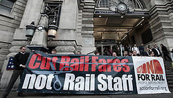 © Licensed to London News Pictures. 14/08/2012. A passenger protest against rising train fares, organised by the TUC, and held at Waterloo Rail Station.  This coincides with the release of July inflation figures which determines how much the increase will be for 2013, and also involves the groups Action for Rail (ASLEF, RMT, TSSA and Unite), Bring Back British Rail, The Campaign for Better Transport, and Climate Rush.  A protest held by Fair Fares Now was held simultaneously alongside it.    Photo credit : Richard Isaac/LNP