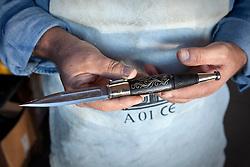 """Avigliano (PZ), 04-10-2010 ITALY - Vito Aquila, artigiano di Balestre. Il coltello di Avigliano, comunemente conosciuto come """"balestra"""", impreziosito con decorazioni in argento e ottone che le conferivano un certo valore non solo artistico,ha identificato per tutto l'Ottocento e parte del Novecento il carattere fiero e risoluto del popolo aviglianese, come attestato in una lunga casistica di riscontri documentari. La """"balestra"""" è un'arma a tutti gli effetti, ed è già considerata -nell'ambito delle manifatture di ferro - oggetto di pregio. Per l'approvvigionamento dell'argento e dell'ottone destinati alla decorazione del manico del coltello gli armieri si rivolgevano agli orefici o agli ottonari. La """"balestra"""" era un'arma del popolo, pronta ad essere impiegata, a seconda delle circostanze, per la difesa o l'offesa tanto dagli uomini quanto dalle donne. Queste, la ricevevano come regalo di fidanzamento dal rispettivo promesso sposo per meglio difendere il proprio onore, perpetrando un'usanza molto sentita almeno fino ai primi decenni del '900..Nella Foto: Balestra finita."""