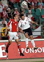 Fotball<br /> VM-kvalifisering<br /> 03.09.2005<br /> Polen v Østerrike<br /> Foto: Wrofoto/Digitalsport<br /> NORWAY ONLY<br /> <br /> EMANUEL POGATETZ (L) from Austria challenges for the ball with MACIEJ ZURAWSKI from Poland