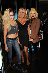 Left to right, ALICE DELLAL, PAMELA ANDERSON and PAM HOGG at the premiere of Nokia's N8 short film 'The Commuter' held at Aqua, 30 Argyll Street, London on 25th October 2010.
