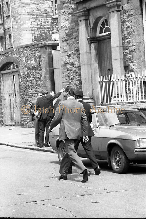 Bomb Damage, Green St. Court.15/07/1976.07/15/1976.15th July 1976..Photograph of Justice O' Hogan (wearing hat) getting into a car after the bombing of the Special Criminal Court, Green Street.