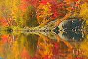 Autumn colors  and Precambrian Shield rock reflected in Simon Lake<br />Simon Lake Park Conservation Area<br />Ontario<br />Canada