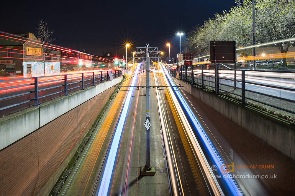 Light trails from trams and passing traffic draw you into this colourful and dynamic scene on Upper Hanover Street in Sheffield. Rush hour in South Yorkshire. Urban landscape photgraphy at dusk, UK.