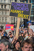 Economics teachers against Brexit - Unite for Europe march attended by thousands on the weekend before Theresa May triggers article 50. The march went from Park Lane via Whitehall and concluded with speeches in Parliament Square.