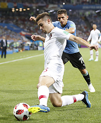 SOCHI, June 30, 2018  Raphael Guerreiro (L) of Portugal vies with Lucas Torreira of Uruguay during the 2018 FIFA World Cup round of 16 match between Uruguay and Portugal in Sochi, Russia, June 30, 2018. (Credit Image: © Ye Pingfan/Xinhua via ZUMA Wire)