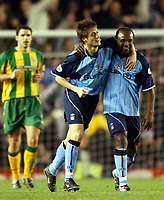 Photograph: Scott Heavey.<br />Coventry v West Bromwich Albion. Nationwide Division One. 20/12/2003.<br />Johnnie Jackson and Patrick Suffo (both subs) who crafted the winning goal