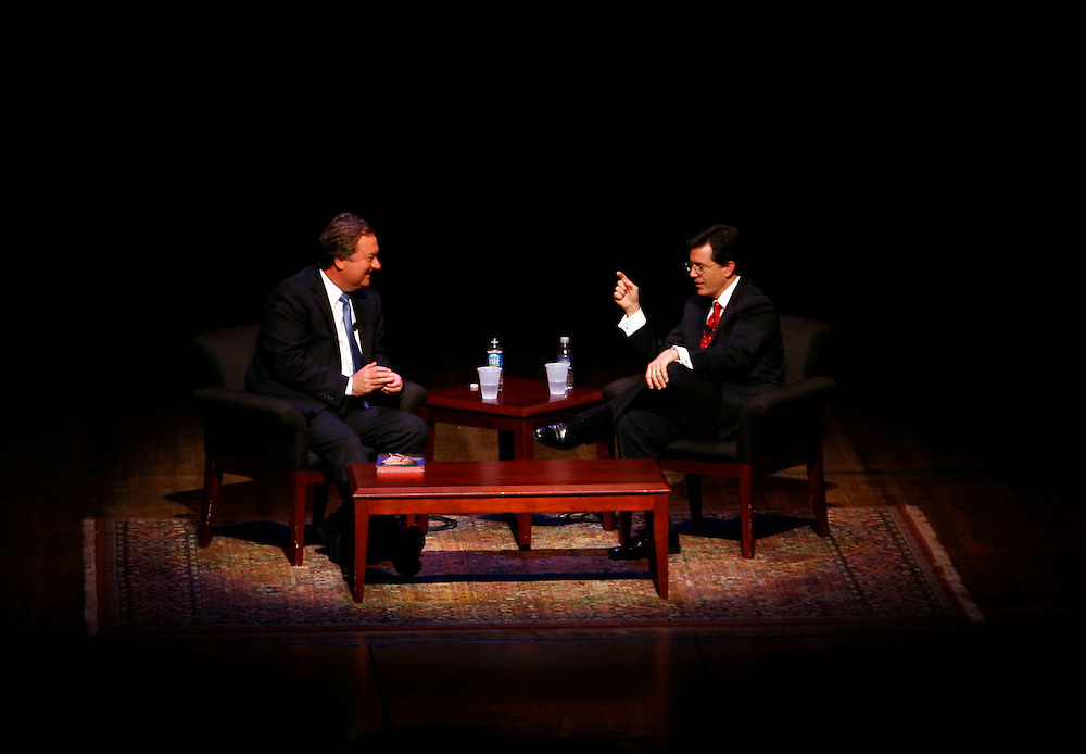 """Washington, Oct. 19, 2007 - Actor and comedian Stephen Colbert, right,  gestures while discussing his new book, """"I Am America (And So Can You)"""" with Tim Russert, left, during a book tour stop at George Washington University on Friday, Oct. 19, 2007 in Washington."""