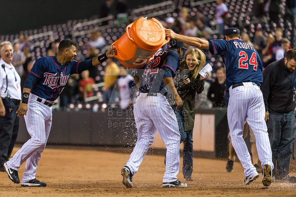Aaron Hicks #32 of the Minnesota Twins gets Gatorade dumped on him by teammates Trevor Plouffe #24 and Eduardo Escobar #5 as Fox Sports North reporter Jamie Hersch avoids the splash after the Twins defeated the Chicago White Sox on May 13, 2013 at Target Field in Minneapolis, Minnesota.  Hicks hit 2 home runs in the game and also robbed a home run.  The Twins defeated the White Sox 10 to 3.  Photo: Ben Krause