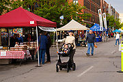 15 MAY 2021 - DES MOINES, IOWA: Shoppers at the Des Moines Farmers Market Saturday. The Des Moines Farmers Market is the largest weekly Farmers Market in Iowa. The market was largely cancelled in 2020 because of COVID-19 pandemic, but reopened in a limited way in 2021. In order to comply with Coronavirus safety guidelines, traffic is one way past the stands and people are required to wear face masks. Traditionally about 25,000 people attended the Saturday morning market, and about 40,000 people attended market on the opening day, the first Saturday in May. This year there will be about 115 vendors, 75% the normal number of vendors. As the CDC rolls back Coronavirus guidelines, the market is expanding. The market will expand Memorial Day weekend to include prepared food stands and children's activities.         PHOTO BY JACK KURTZ
