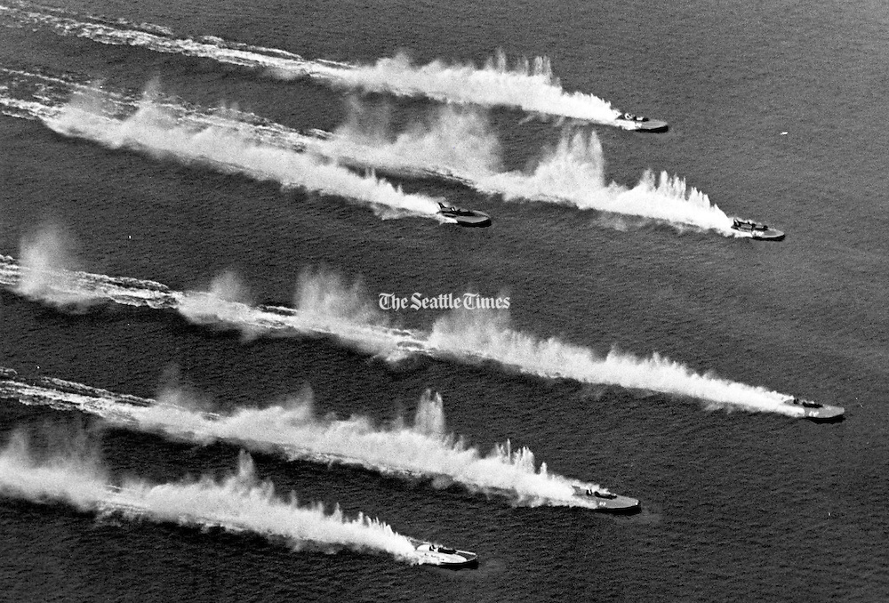 The six -finalists in the Seafair Trophy Race on Lake Washington charged across the starting line with their roostertails showing. The boats were, from top to bottom, Miss Budweiser, Wayfarers Club Lady, My Gypsy, Dixi Cola, Tahoe Miss and Miss Madison. The heat was stopped when Miss Budweiser flipped. Tahoe Miss won the rerun. My Gypsy won the race. (Larry Dion / The Seattle Times, 1966)