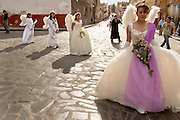 07 APRIL 2004 - SAN MIGUEL DE ALLENDE, GUANAJUATO, MEXICO: Women dressed as angels during a Holy Wednesday Stations of the Cross procession through San Miguel de Allende, GTO, MEX. Semana Santa, the week before Easter is celebrated with extreme piety in central Mexico. San Miguel, which was founded in the 1600s, is one of Mexico's premier colonial cities. It has very strict zoning and building codes meant to preserve the historic nature of the city center. About 7,500 US citizens, mostly retirees, live in San Miguel. PHOTO BY JACK KURTZ