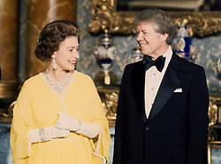 File photo dated 07/05/77 of Queen Elizabeth II with the then US President Jimmy Carter at a State Dinner at Buckingham Palace in London.
