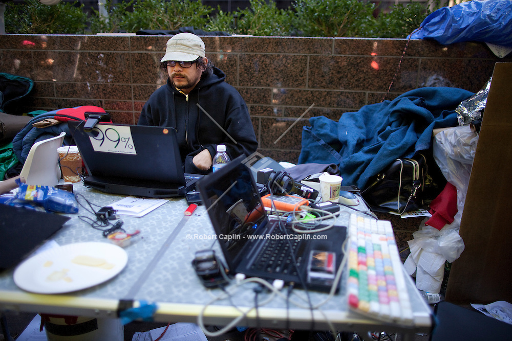 The media/press area at the Occupy Wall Street protest in New York's Zuccotti Park...Photo by Robert Caplin.