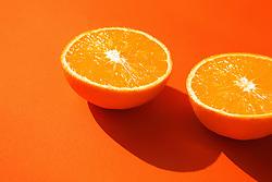Halved Orange on Orange Background