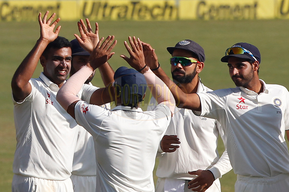 Ravichandran Ashwin of India celebrates the wicket of Chris Woakes of England during day 5 of the fourth test match between India and England held at the Wankhede Stadium, Mumbai on the 12th December 2016.<br /> <br /> Photo by: Deepak Malik/ BCCI/ SPORTZPICS