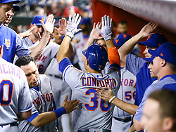 June 14, 2018 - Phoenix, AZ, U.S. - PHOENIX, AZ - JUNE 14: The New York Mets dugout congratulates New York Mets left fielder Michael Conforto (30) after hitting a homer during the MLB baseball game between the Arizona Diamondbacks and the New York Mets on June 14, 2018 at Chase Field in Phoenix, AZ (Photo by Adam Bow/Icon Sportswire) (Credit Image: © Adam Bow/Icon SMI via ZUMA Press)