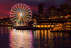 United States, Washington, Seattle. The Seattle Great Wheel on the waterfront in downtown Seattle in the evening.