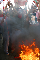 Pro-Syrian and Hezbollah protesters counter-demonstrate in front of the American Embassy in Beirut, Lebanon, March 15, 2005. They are protesting in response to the thousands that have demanded an end to Syria's near-three decade military domination of Lebanon.