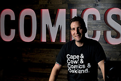 Eitan Manhoff, owner of Cape & Cowl Comics in the Uptown neighborhood of Oakland, Calif., poses for a photograph his shop, Tuesday, Nov. 24, 2015. (D. Ross Cameron/Bay Area News Group)