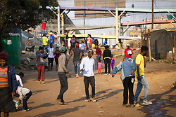 August 14, 2018 - Soweto, MN - Minnesota, SOUTH AFRICA - People walk down the street in the afternoon in Kliptown, Soweto. ....BACKGROUND INFORMATION: Soweto, South Africa on Tuesday, August 14, 2018. (Credit Image: © TNS via ZUMA Wire)